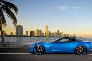 blue sports car on sea side